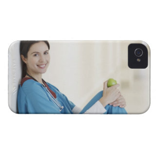 Nurse sitting with apple in hospital corridor iPhone 4 Case-Mate case