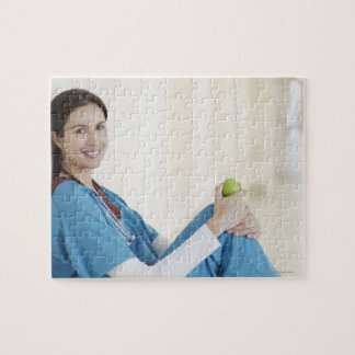 Nurse sitting with apple in hospital corridor jigsaw puzzle