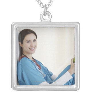Nurse sitting with apple in hospital corridor personalized necklace