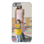 Nursery teacher by girl (3-5) with painting, barely there iPhone 6 case