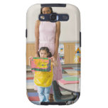 Nursery teacher by girl (3-5) with painting, samsung galaxy s3 cover