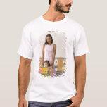 Nursery teacher by girl (3-5) with painting, T-Shirt