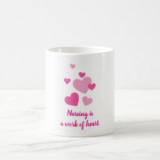 Nursing is a work of heart pink design coffee mug