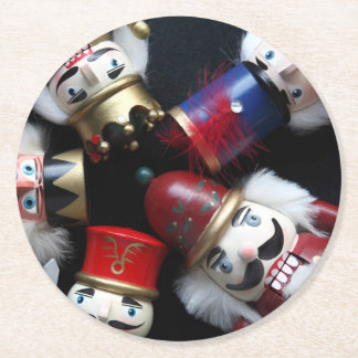 Nutcrackers heads together round paper coaster