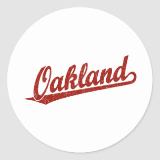 Oakland script logo in red distressed classic round sticker