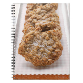 Oat biscuits on plate notebooks