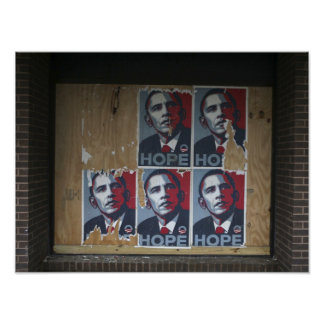 Obama signs in a boarded window of a closed