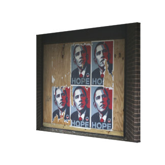 Obama signs in a boarded window of a closed canvas print