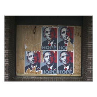 Obama signs in a boarded window of a closed photographic print