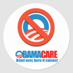 Obamacare - Bend over here it comes Round Sticker
