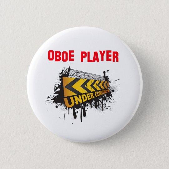 Oboe player under construction 6 cm round badge