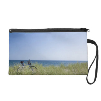 Ocean and horizon with clear blue sky wristlet purse