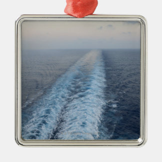 Ocean view of wake from the rear of a cruise christmas ornament