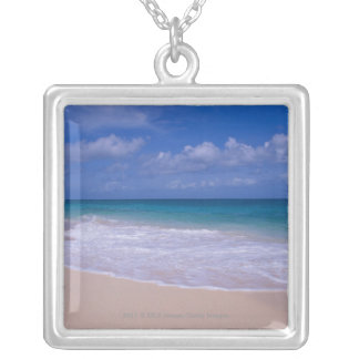 Ocean waves foaming onto sandy beach silver plated necklace