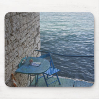Oceanside seating for two at tiny outdoor cafe, mouse pad
