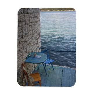 Oceanside seating for two at tiny outdoor cafe, rectangular photo magnet