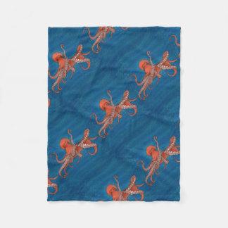 Octopus approaching fleece blanket