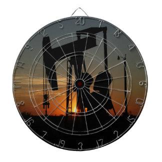 Oil Pump Jack At Sunset Dartboards