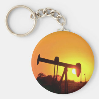 Oil well pump at sunset, Illinois, U.S.A. Basic Round Button Key Ring
