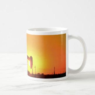 Oil well pump at sunset, Illinois, U.S.A. Coffee Mug
