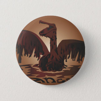 oiled brown pelican- 6 cm round badge