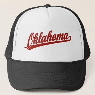 Oklahoma script logo in red trucker hat