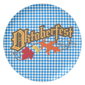 oktoberfest text and autumn leaves plate