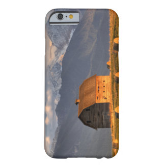 Old barn framed by hay bales and dramatic barely there iPhone 6 case