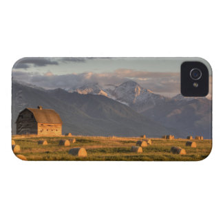 Old barn framed by hay bales and dramatic iPhone 4 cover
