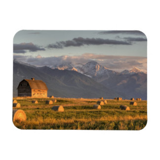 Old barn framed by hay bales and dramatic vinyl magnets