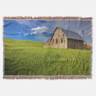 Old Barn in Field of Spring Wheat Throw Blanket
