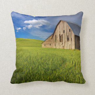 Old Barn in Field of Spring Wheat Throw Pillow