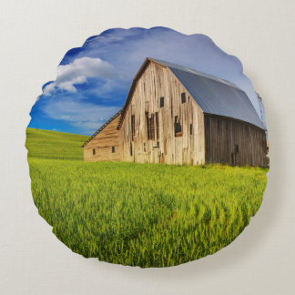 Old Barn Surrounded by Spring Wheat Field 1 Round Cushion