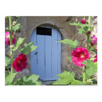 Old blue door with honeysucle postcard