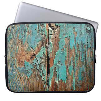 Old blue paint on wood laptop sleeve