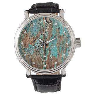 Old blue peeling paint on wood grunge unusual watch