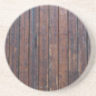 Old Brown Wood Doors With Black Iron Supports Beverage Coaster