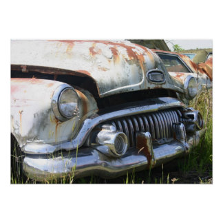 Old Car in a Junkyard Poster