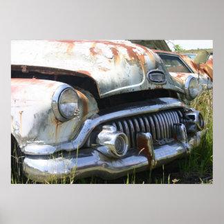 Old Car in a Junkyard Poster