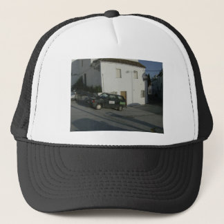 Old car in Spanish Street Trucker Hat