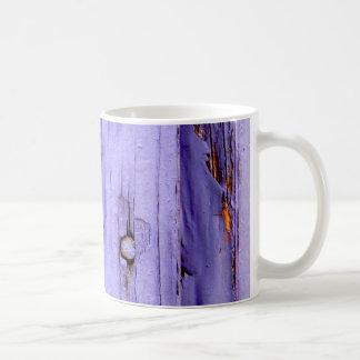 Old cracked purple paint on wood mugs