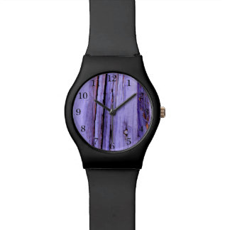 Old cracked purple paint on wood watch