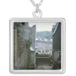 Old-fashioned architecture in canal city, silver plated necklace