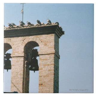 Old-fashioned church bells, Assisi, Italy Tile