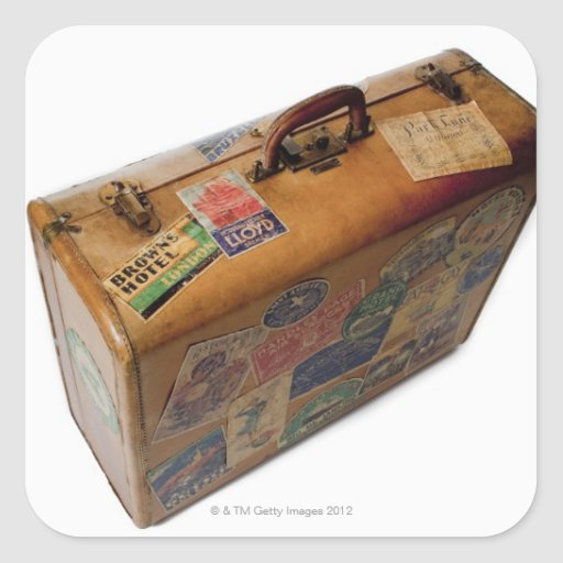 'Old Fashioned Suitcase With Travel Stickers