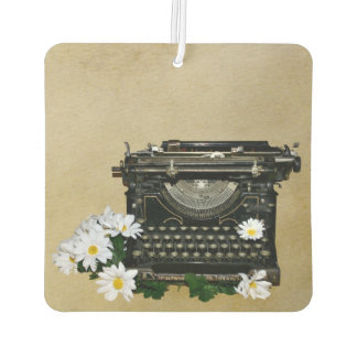 Old fashioned typewriter and daisies