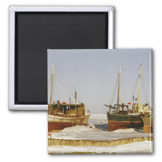 Old-fashioned, weathered fishing boats beached square magnet