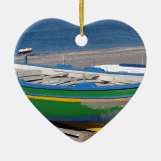 Old green fishing boat on beach. christmas ornament