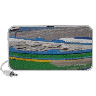 Old green fishing boat on beach iPhone speaker