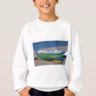 Old green fishing boat on beach. sweatshirt